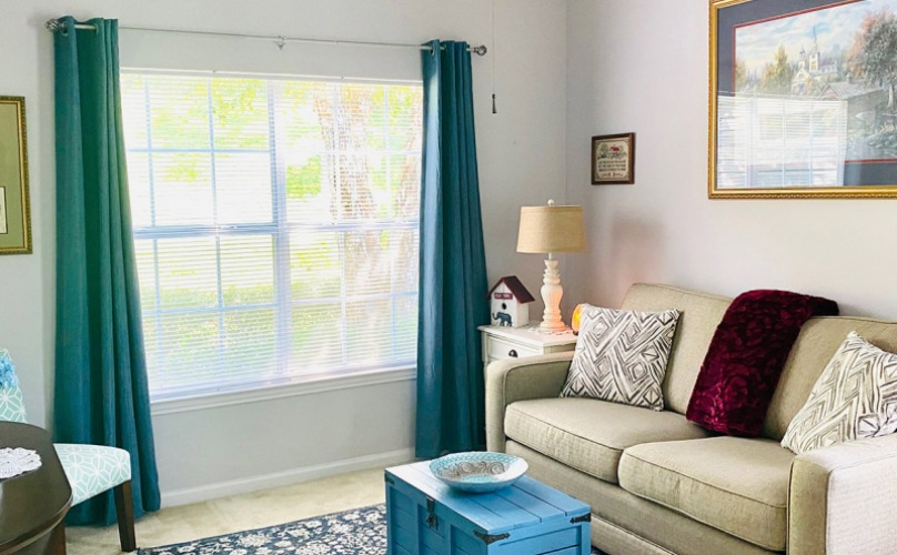 living room with large, bright window